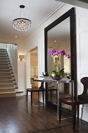 view in gallery large full length mirror with table and chairs in entryway
