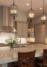lighting island. love counters and cabinet color rich different lighting island