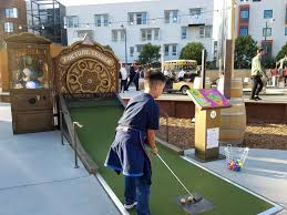 with a mini golf course food trucks a beer garden and tents for escaping