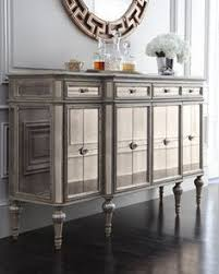 dresden four door mirrored console reflective console with multiple storage options made of hardwood with an antique cream finish silvery accents
