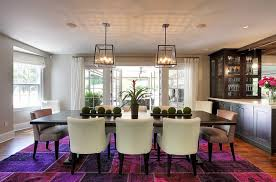 view in gallery fabulous rug in multiple shades of purple steals the show in this dining room design