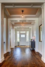 love how spacious this feels and the contrast of light dark floors with white trim