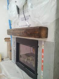 installing a barn beam mantel before the stone is the best option here is one