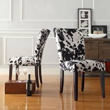 black cowhide fabric print parsons chair set of two with sideboard and wall molding