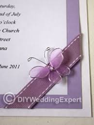 purple erfly on a diy wedding invitation