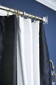 use curtain rings to give your bought inexpensive curtains a luxe custom made