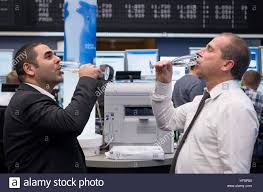 Stock Brokers Two Stockbrokers Drink Glasses Of Prosecco In The Trading Room Of