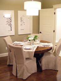 adorable dining room ideas with slip cover for chair and round wooden dining room plus attractive