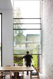a polished concrete floor in the bat extends out to the garden where a planted green wall allows maximum use of the terrace for entertaining