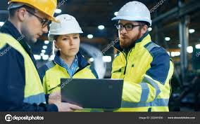Male Female Industrial Engineers Talk Factory Worker While Using