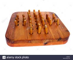Wooden Peg Solitaire Game A Peg Solitaire board Stock Photo 100 Alamy 24