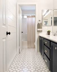 i know this is probably going to be hard to believe but that beautiful bathroom above used to look like this again she did not put down new tile she
