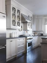 white cabinet doors with glass. kitchen cabinet:stainless steel refrigerator white glass cabinet doors black granite countertop dark hardwood with