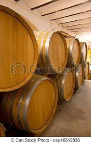 stacked oak barrels. Wine Wooden Oak Barrels Stacked In A Row At Winery - Csp16512836