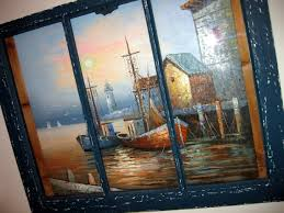 old window reused as a striking frame for an oil painting 3 strips of wood
