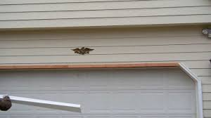 installing aluminum casings covering over wood garage door