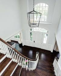 lantern style foyer chandelier a stately lantern style light fixture hangs above the homes two story
