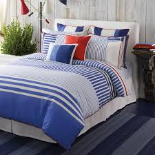 triple colored nautical bedding style with fresh marine stripes comforter and rustic wood wall bedroom
