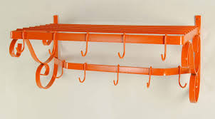 wall mounted pot rack in bold tangerine orange finish