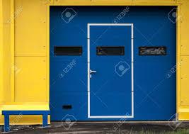 modern door texture. Stock Photo - Texture Of Modern Yellow Garage Wall With Closed Blue Gate Door E