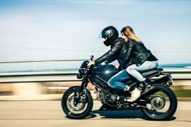 how helmet laws affect motorcycle insurance rates