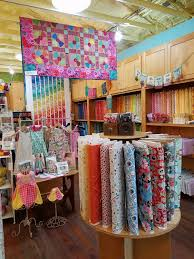 Valli & Kim Quilt Store, Dripping Springs, TX | Dragonfly Quilts Blog & ... backdrop for the numerous quilt samples and displays of racks of  fabrics. The place has a modern, fresh feel appealing to both the younger  new quilters ... Adamdwight.com