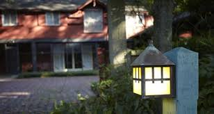arts and crafts exterior wall lighting. a lantern mounted on post lights the driveway leading up to red house. arts and crafts exterior wall lighting r