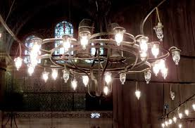 note the electrified oil lamp chandeliers which help light the hall detail of one chandelier below