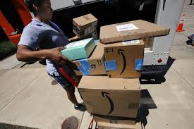 in this july 19 2018 photo a u s postal carrier delivers amazon orders