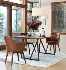 rejuvenation dexter arm chair 499 vs urban outfitters nora saddle chair 129 leather dining chair look