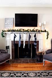 DIY stocking holder: use a curtain rod | via