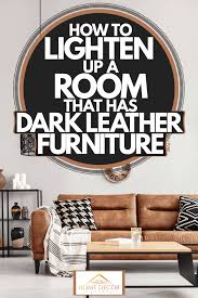 room that has dark leather furniture