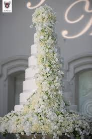 flower wedding cake. white big wedding cake with and yellow flowers flower