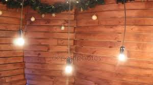 Slide Camera Burning Lights On Wires On A Wooden Background With