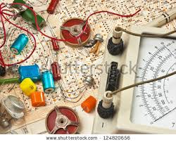 electric circuit diagram stock images royalty images old electronic components lie on the wiring diagram