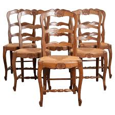 set of 6 french oak ladder back chairs with rush seats