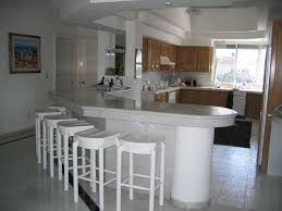Kitchen:Modern Kitchen Breakfast Bar Table Design With White Marble  Countertop And Round Wooden Stools