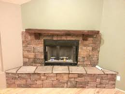 wood burning fireplace construction a rustic gas with darker cedar mantel and bricks material surround construct