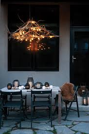 rustic chandelier tree branches backyard outdoor entertaining evening