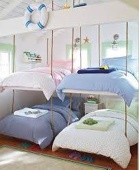 Bunk beds suspended from ceiling with rope