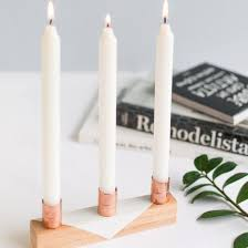 Make this cute candle holder using wood sticks and copper pipes. Pretty  easy! (