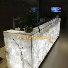 fully lit faux onyx reception counter
