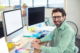 Designer Stock Photo Portrait Of Smiling Graphic Designer Working On Computer In Office 799880