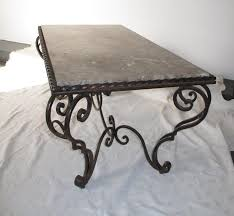 a rare creamy brown marble on heavy beautifully wrought iron base in