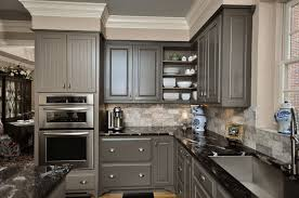 grey kitchen cabinets with patterned black granite countertop