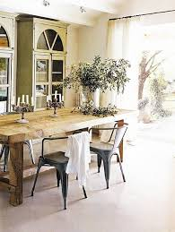 french country style dining e trestle table tolix chairs green armoires