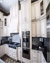 Kitchen With White Cabinets And Black Countertops 25 The
