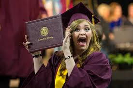 commencement in photos asu now access excellence impact student holding up diploma