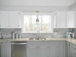 White Kitchen Cabinet Makeover Our Oak Kitchen Makeover Gray Subway Tiles White Cabinets And