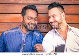 homosexual couple stock images royalty images vectors multiracial young business men watching mobile phone screen and smiling n man caucasian friend